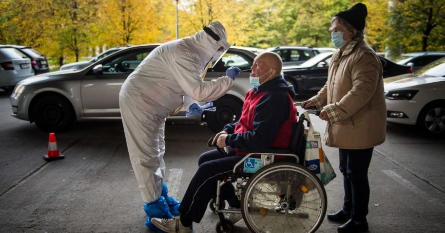 A medic tests a man for the novel coronavirus during nationwide testing in Bratislava, Slovakia, on Saturday.