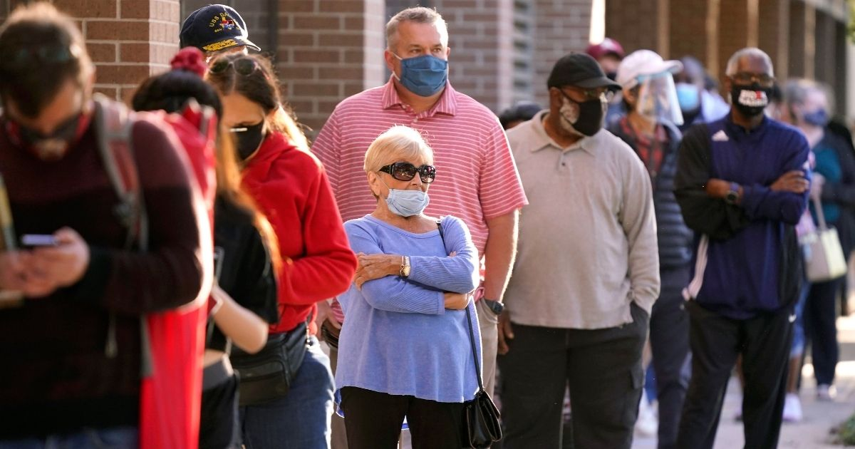 Voters line up for early voting outside Richardson City Hall in Texas on Oct. 13, 2020.