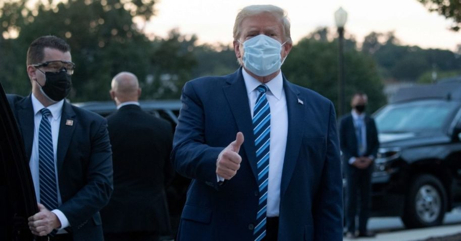 President Donald Trump gives a thumbs-up as he leaves Walter Reed National Military Medical Center in Bethesda, Maryland, and heads toward Marine One on Oct. 5, 2020.