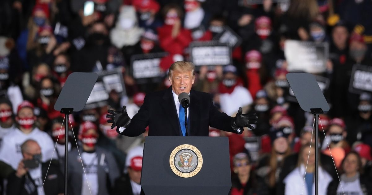 President Donald Trump speaks during a campaign rally at the Waukesha County Airport in Waukesha, Wisconsin, on Saturday.