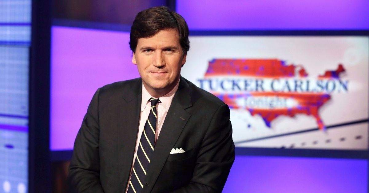 """Tucker Carlson, host of """"Tucker Carlson Tonight,"""" poses for photos in a Fox News Channel studio in New York in this March 2, 2017, file photo."""