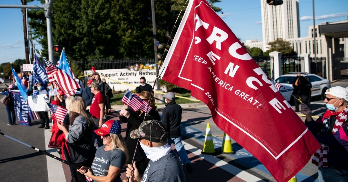 Supporters of President Donald Trump rally outside Walter Reed National Medical Center in Bethesda, Maryland, on Saturday.