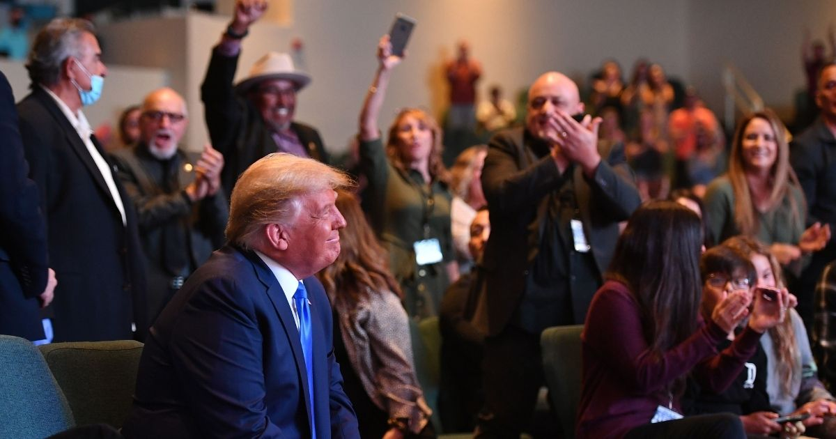 President Donald Trump is cheered by the congregation as he attends a Sunday service at the International Church of Las Vegas in Las Vegas, Nevada, during a campaign swing through the battleground state.