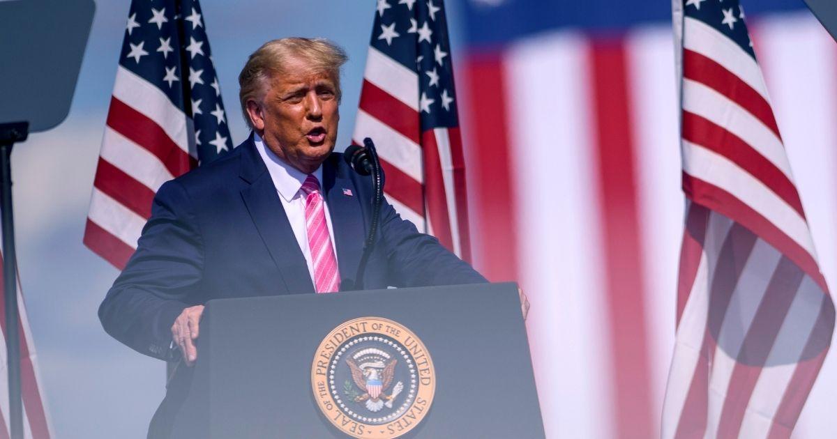 President Donald Trump addresses a rally Saturday in Lumberton, North Carolina.