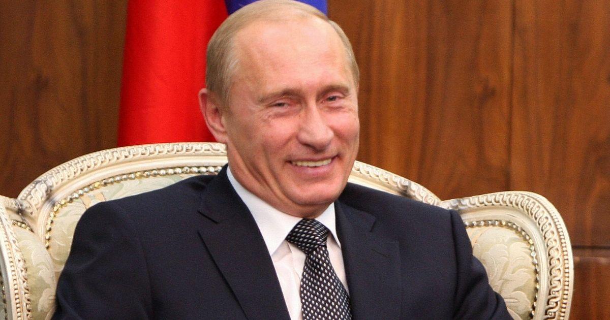 Russian President Vladimir Putin laughs in a 2007file photo.