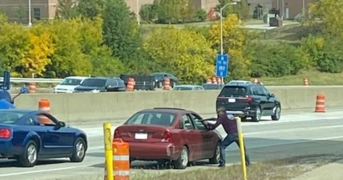 In one of the cellphone photos supplied to police by witnesses, John Patrick Abell points a rifle at Joshua G. Taylor while Taylor sits in his car on the side of Interstate 75 in northern Kentucky on Oct. 9, 2020, according to Kenton County Commonwealth's Attorney Rob Sanders.