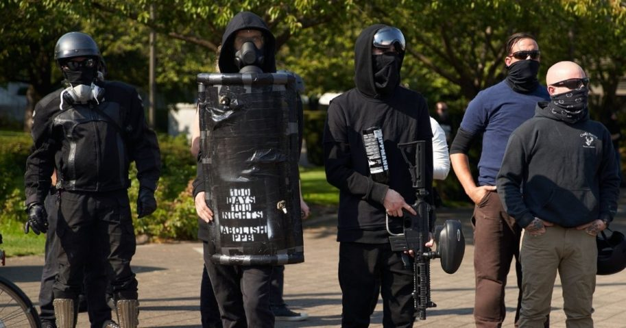 Members of antifa stand in the street as Trump supporters and members of the conservative groups Patriot Prayer and Proud Boys gather in Salem, Oregon, on Sept. 7, 2020.