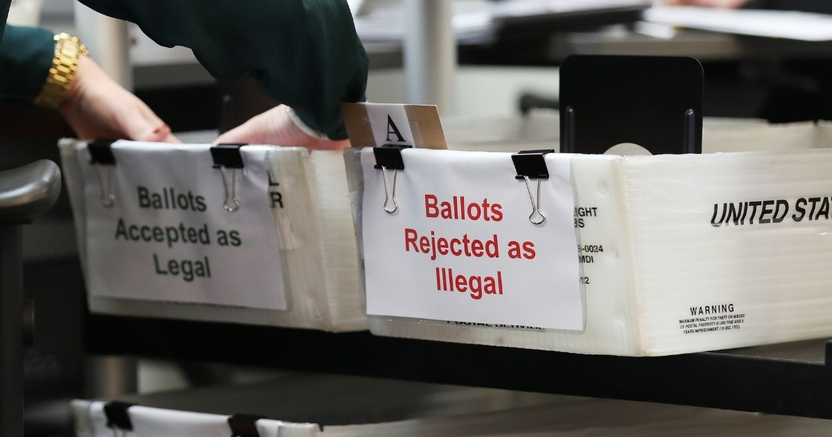 Boxes of mail-in ballots that have been rejected or accepted due to signature discrepancies are seen at the Miami-Dade County Elections Department on Oct. 15, 2020, in Doral, Florida.
