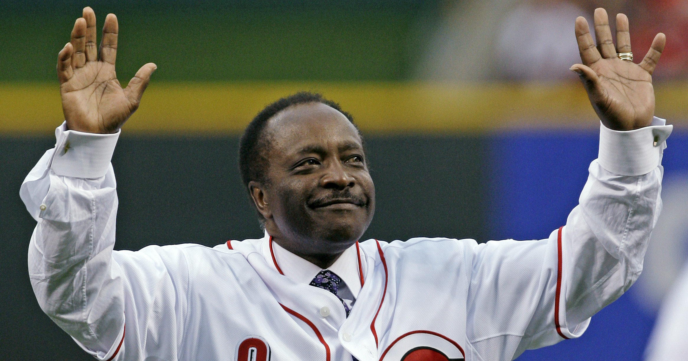 Cincinnati Reds Hall of Fame second baseman Joe Morgan acknowledges the crowd after throwing out a ceremonial first pitch prior to the Reds' game against the St. Louis Cardinals on April 7, 2010.