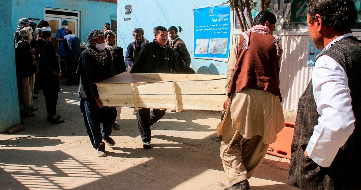 Relatives carry the coffin of a victim who was killed by a roadside bomb in Ghazni province, Afghanistan, on Oct. 24, 2020.