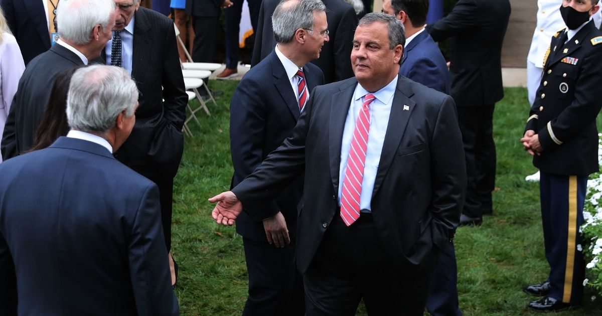 Former New Jersey Governor Chris Christie talks with guests in the Rose Garden after President Donald Trump introduced Amy Coney Barrett as his nominee to the Supreme Court at the White House on Sept. 26, 2020, in Washington, D.C.