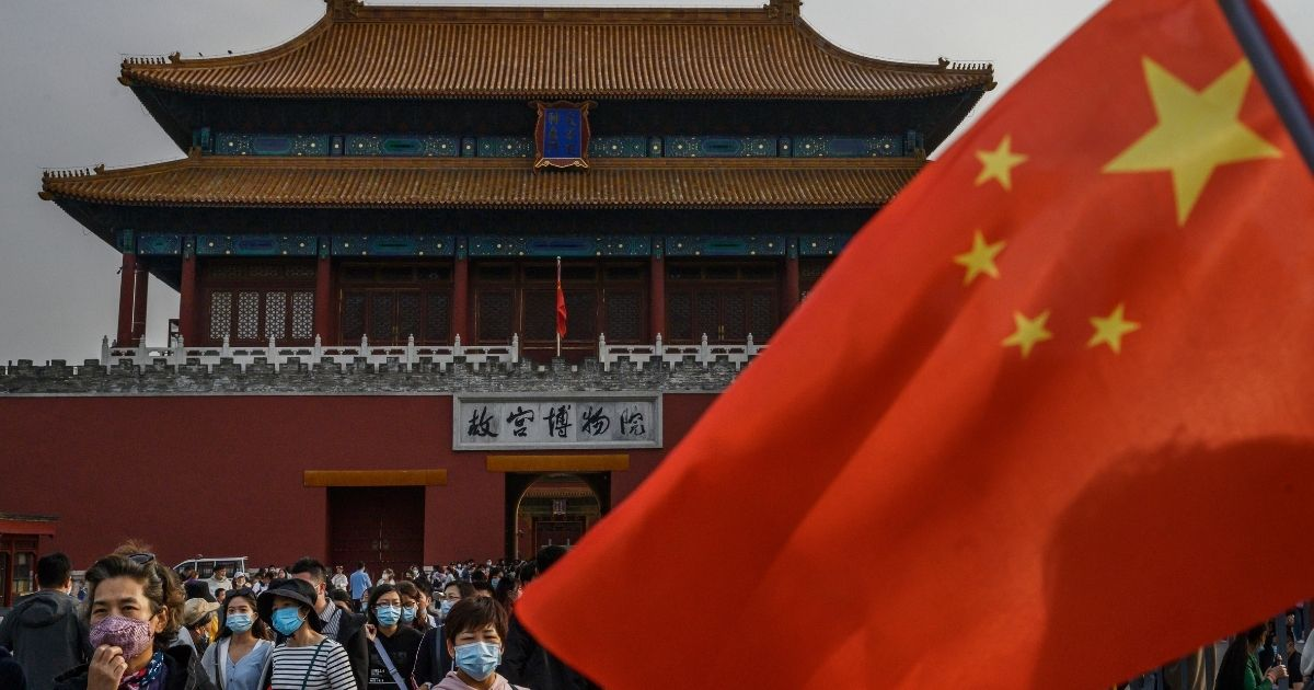 Tourists leave the Forbidden City on Oct. 6, 2020, in Beijing.
