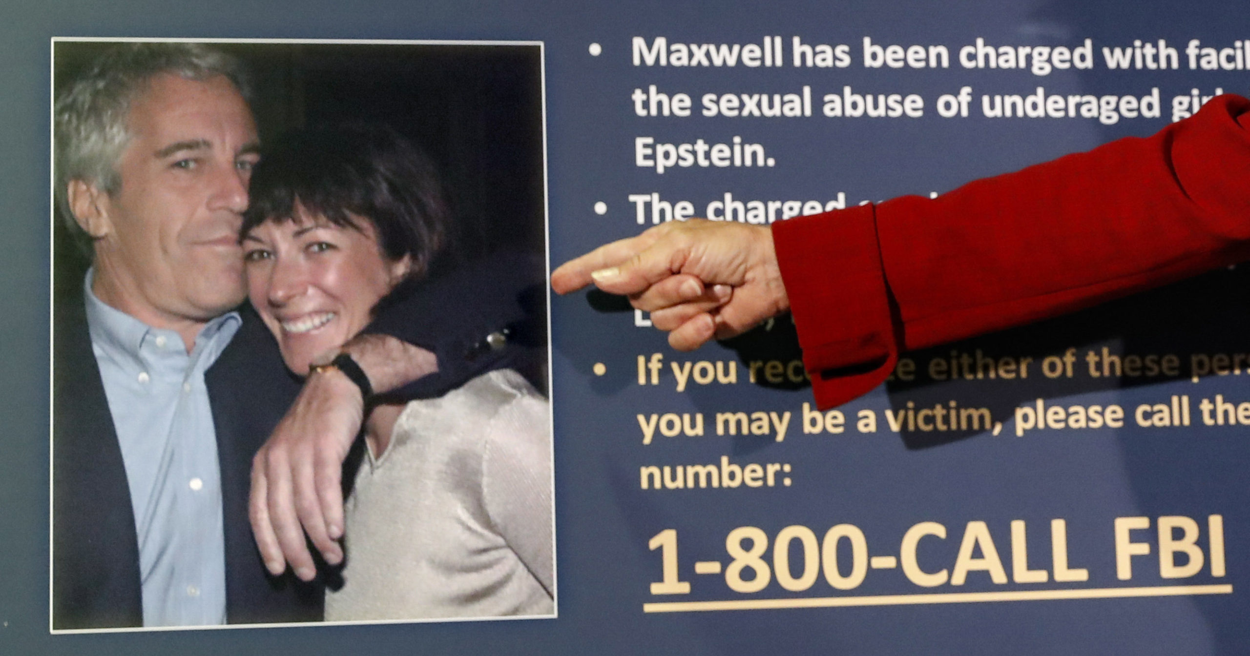 In this July 2, 2020, file photo, Audrey Strauss, acting United States Attorney for the Southern District of New York, points to a photo of Jeffrey Epstein and Ghislaine Maxwell during a news conference in New York.