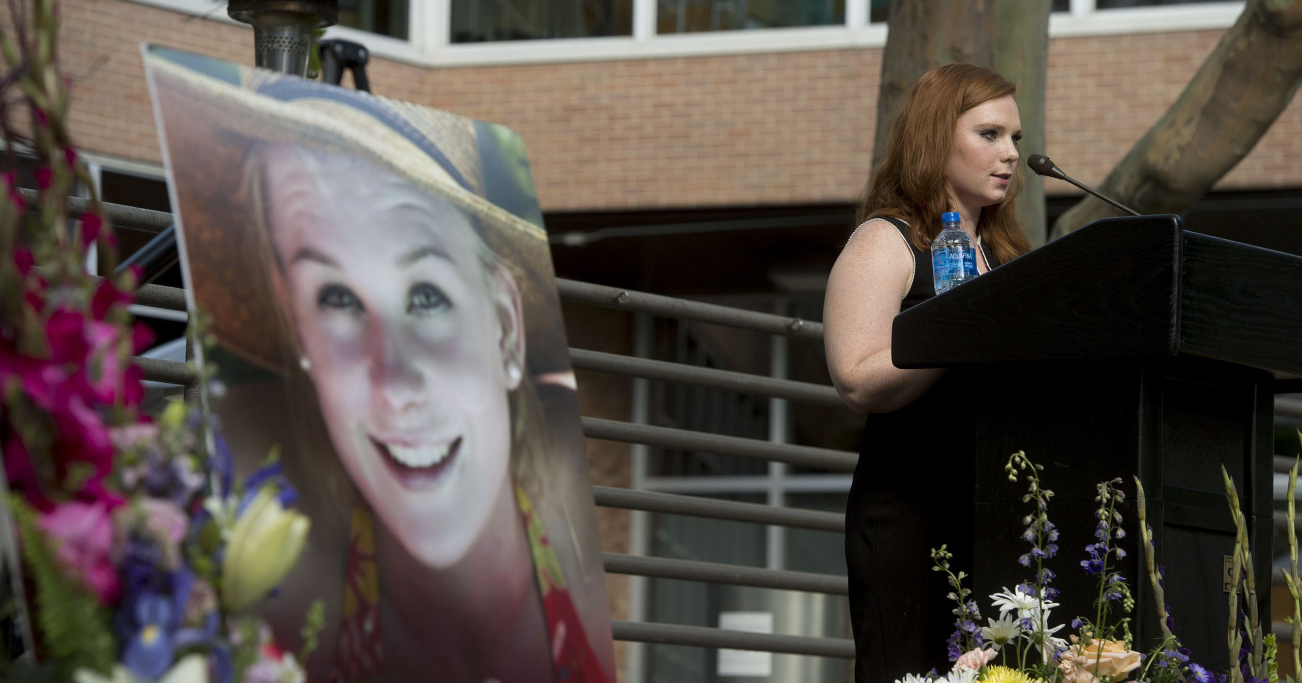 In this July 1, 2019, file photo, Ashley Fine speaks during a vigil for Mackenzie Lueck in Salt Lake City.