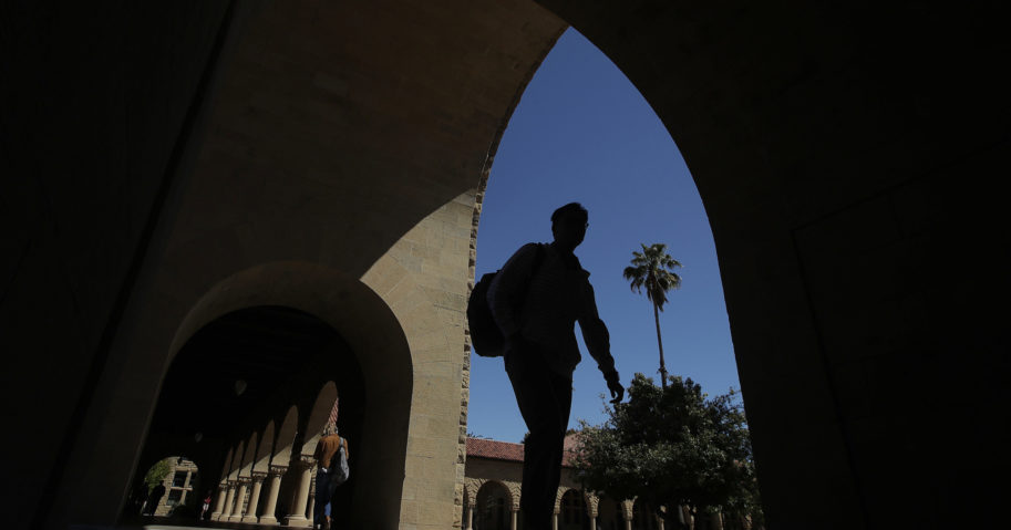 In this April 9, 2019, file photo, pedestrians walk on the campus of Stanford University in Stanford, California.