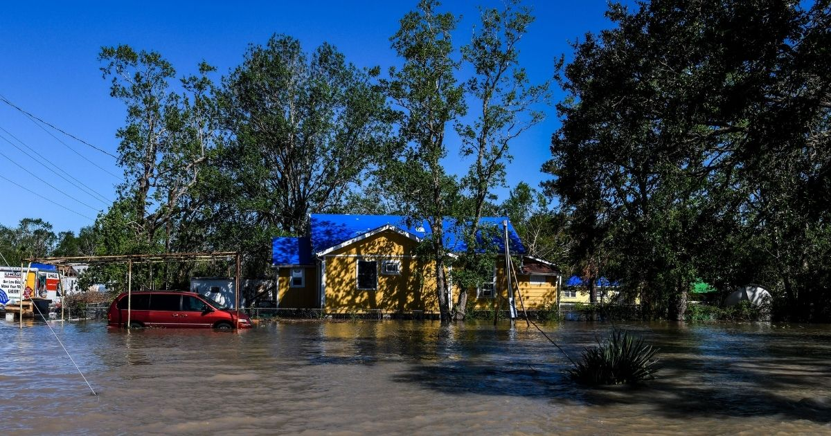 Houses are surrounded by flood waters after Hurricane Delta passed through on Oct. 10, 2020, near Lake Charles, Louisiana.