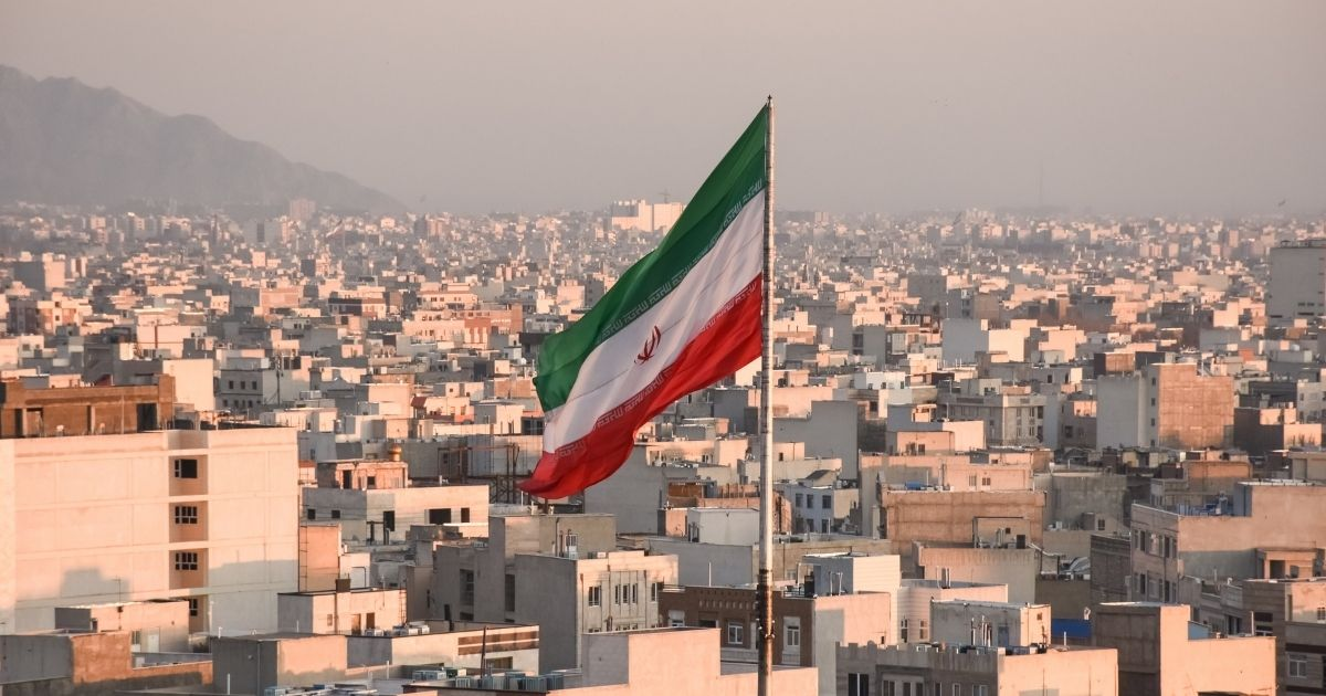 The Iranian flag flies over Tehran in this stock image.