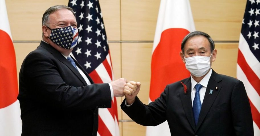Japanese Prime Minister Yoshihide Suga and US Secretary of State Mike Pompeo greet prior to their meeting at the prime minister's office in Tokyo on Oct. 6, 2020.