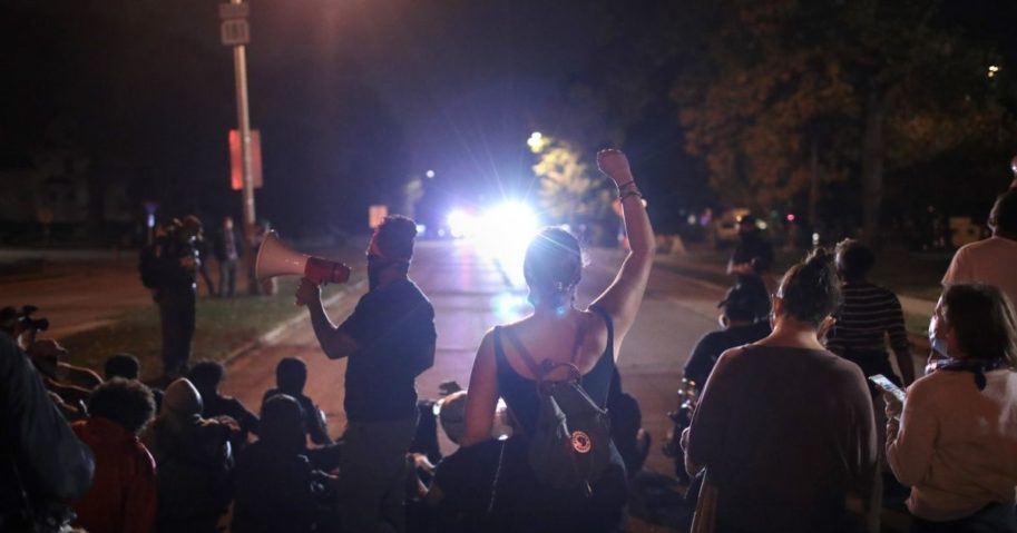 Protesters confront police near Wauwatosa City Hal on Oct. 9, 2020, in Wauwatosa, Wisconsin.