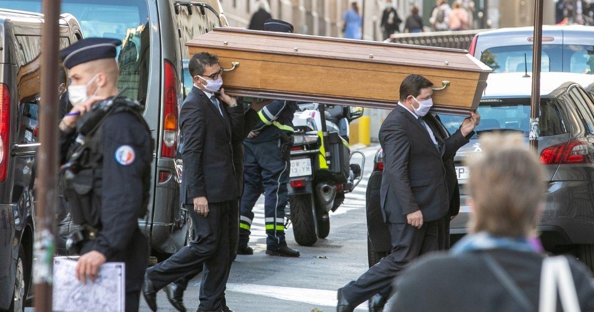 Pallbearers carry Samuel Paty's coffin on Oct. 21, 2020, in Paris.