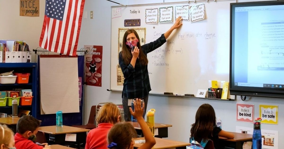 A teacher instructs students at Freedom Preparatory Academy on Sept. 10, 2020, in Provo, Utah.