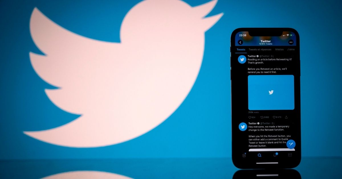 This photograph taken on Oct. 26, 2020, shows the Twitter logo displayed on the screen of a smartphone and a tablet in Toulouse, southern France.