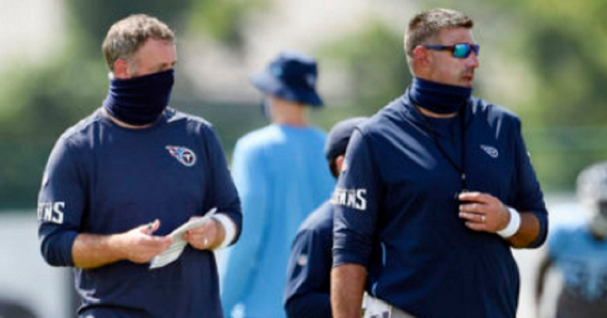 Tennessee Titans outside linebackers coach Shane Bowen, left, and head coach Mike Vrabel watch players during an August training camp in Nashville, Tennessee.