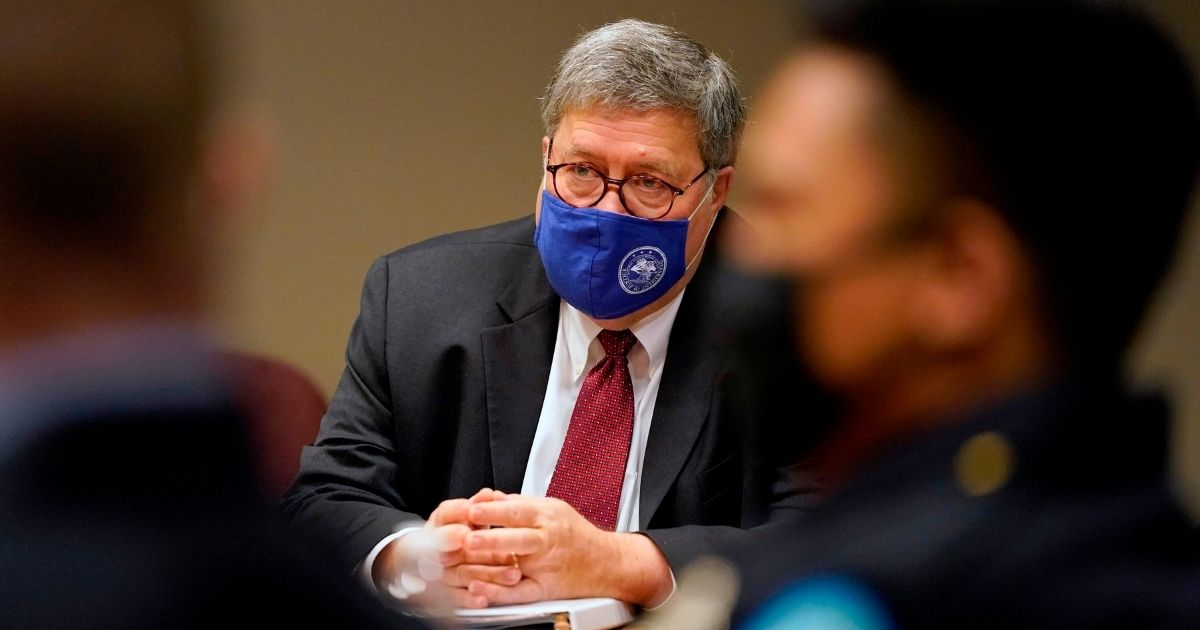 Attorney General William Barr meets with members of the St. Louis Police Department on Oct. 15, 2020, in St. Louis, Missouri.