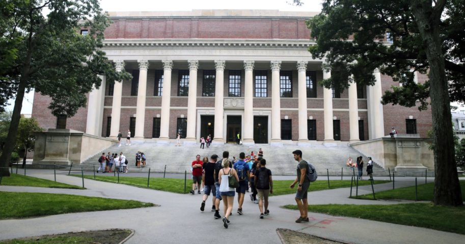 In this Aug. 13, 2019, file photo, students walk on the campus of Harvard University in Cambridge, Massachusetts.
