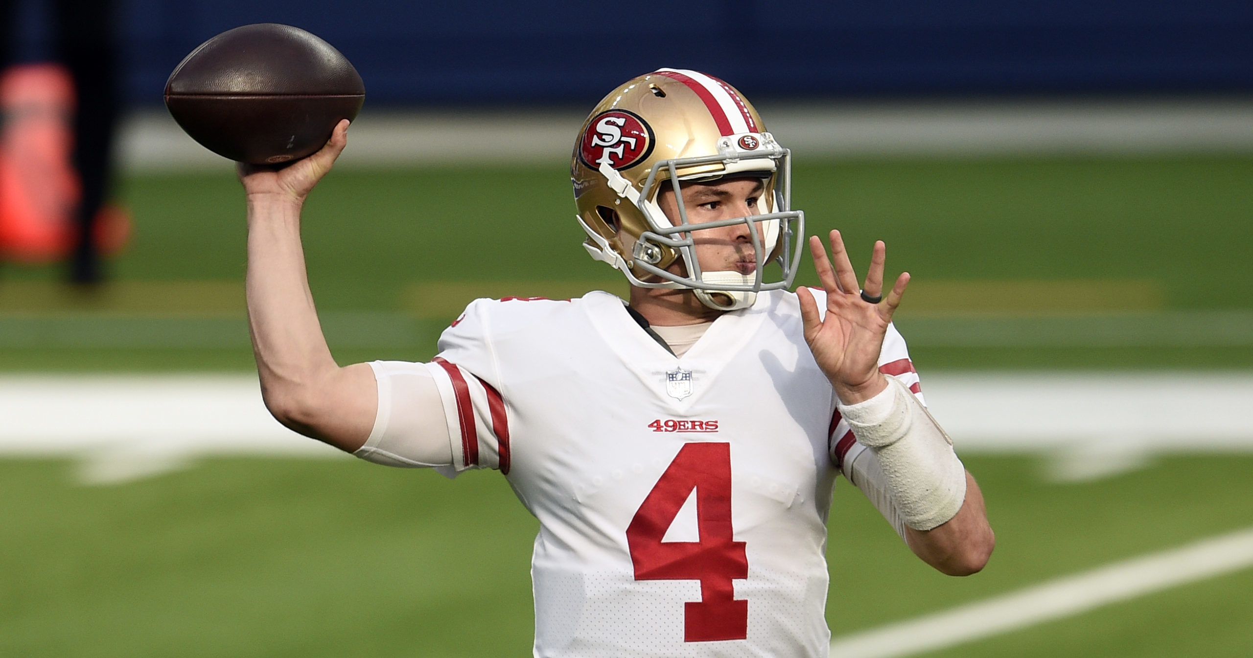 San Francisco 49ers quarterback Nick Mullens throws against the Los Angeles Rams during the first half of an NFL football game on Nov. 29, 2020, in Inglewood, California.