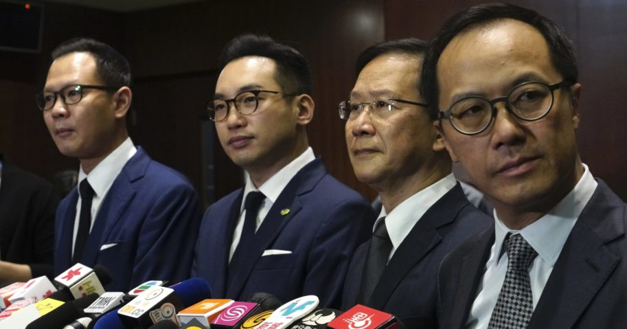 Four pro-democracy lawmakers listen to reporters' questions during a news conference in Hong Kong on Nov. 11, 2020.