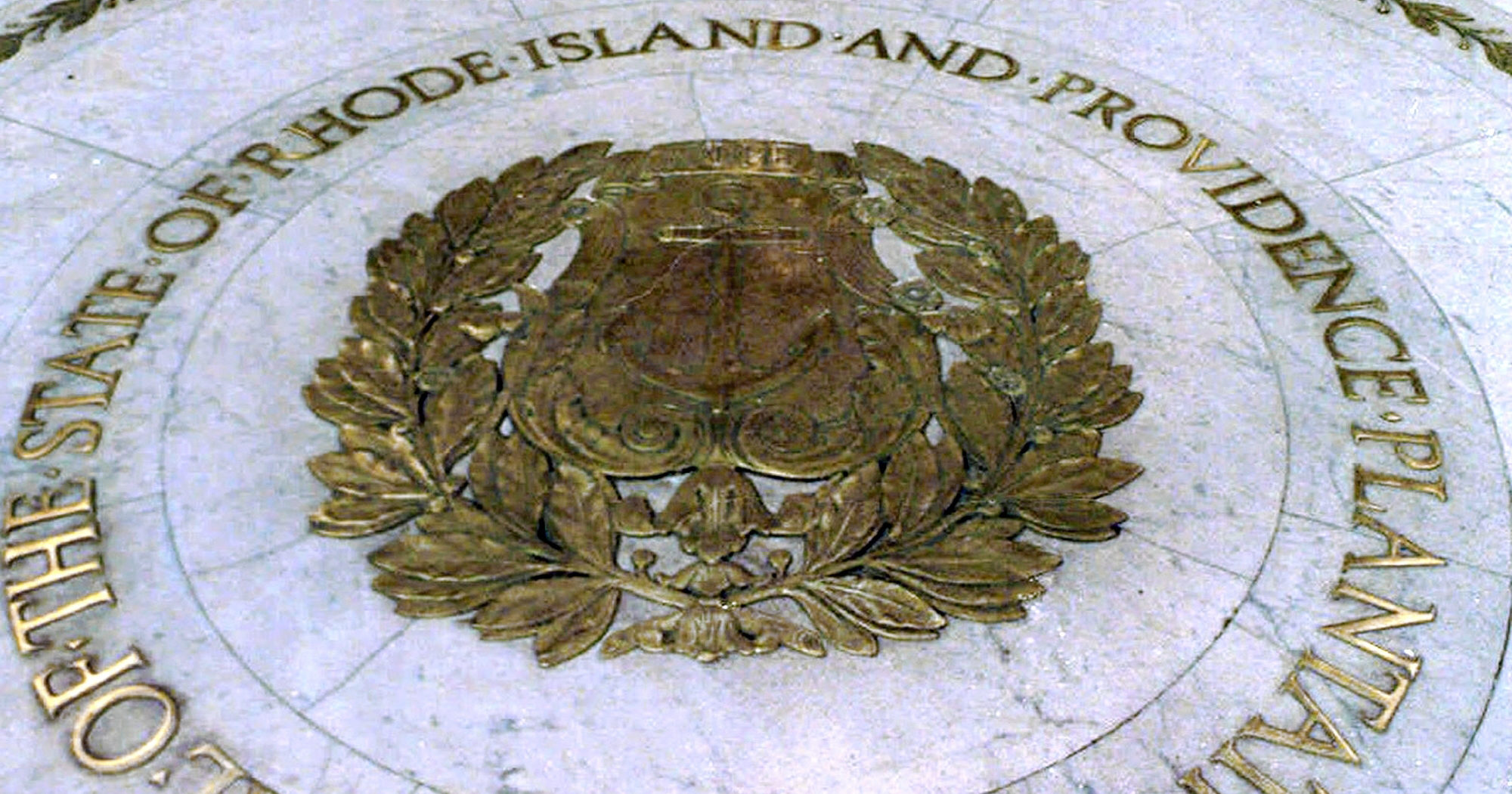 """This Jan. 21, 2000, file photo shows the seal bearing the official name """"State of Rhode Island and Providence Plantations"""" on the floor of the Statehouse rotunda in Providence, Rhode Island."""