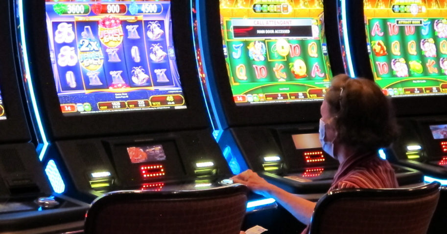 A woman plays a slot machine at the Golden Nugget casino in Atlantic City, New Jersey, on July 2, 2020.