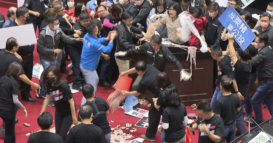 In this image made from video, lawmakers fight during a parliament session in Taipei, Taiwan, on Friday.