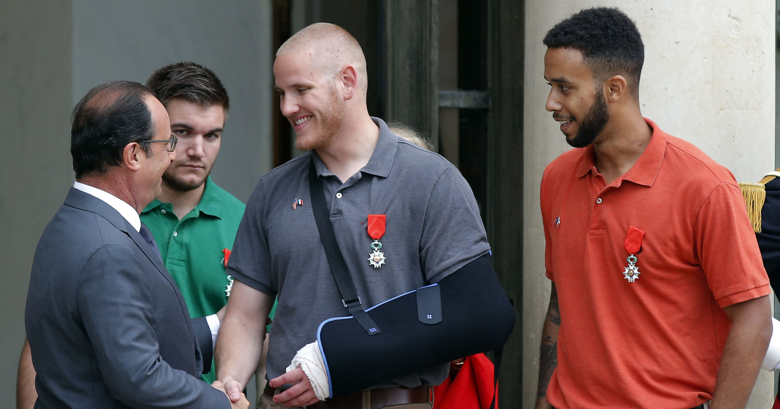 In this Aug. 24, 2015, file photo, French President Francois Hollande awards the French Legion of Honor to US Airman Spencer Stone, US National Guardsman Alek Skarlatos and Anthony Sadler, a student at Sacramento State University in California, at the Elysee Palace in Paris.
