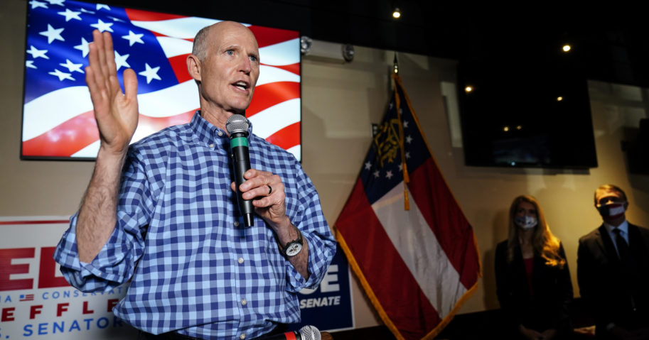 Sen. Rick Scott speaks during a campaign rally for Republican candidates for US Senate Sen. Kelly Loeffler and Sen. David Perdue on Nov. 13, 2020, in Cumming, Georgia.