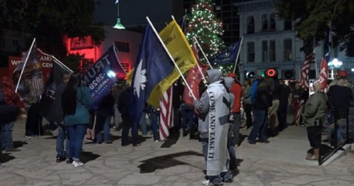 Protesters defy a curfew order in San Antonio, Texas, Friday.