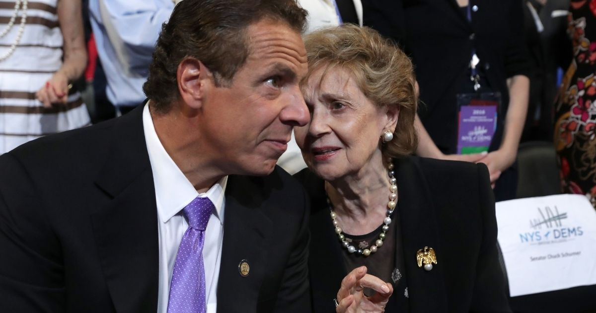 Democratic New York Gov. Andrew Cuomo speaks with his mother Matilda Cuomo during the Democratic National Convention at the Wells Fargo Center on July 28, 2016, in Philadelphia.