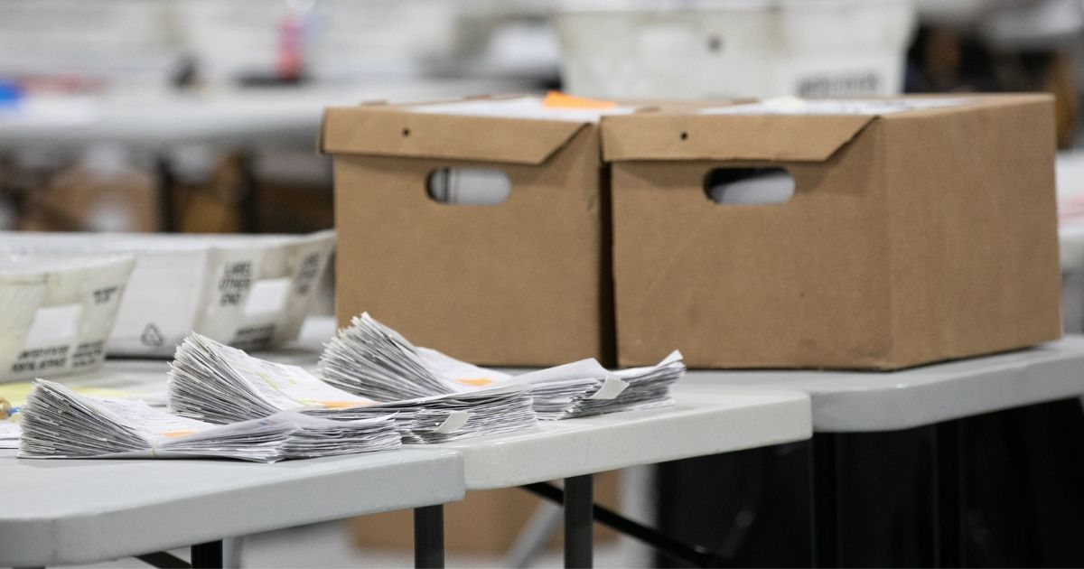 A stack of ballots is in the process of being counted at the Gwinnett Voter Registrations and Elections office in Lawrenceville, Georgia, on Friday.