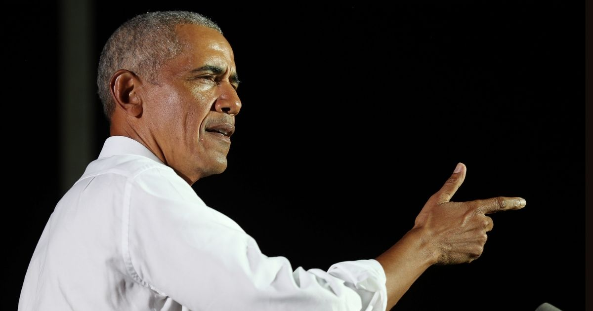 Former President Barack Obama speaks in support of Democratic presidential nominee Joe Biden during a drive-in rally at the Florida International University on Nov. 2 in Miami.