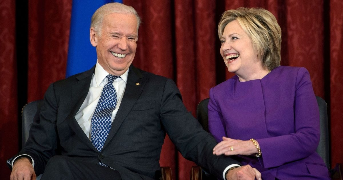 Joe Biden shares a laugh with Hillary Clinton during an event on Capitol Hill in Washington on Dec. 8, 2016, when they were serving as vice president and secretary of state, respectively, in the Obama White House.