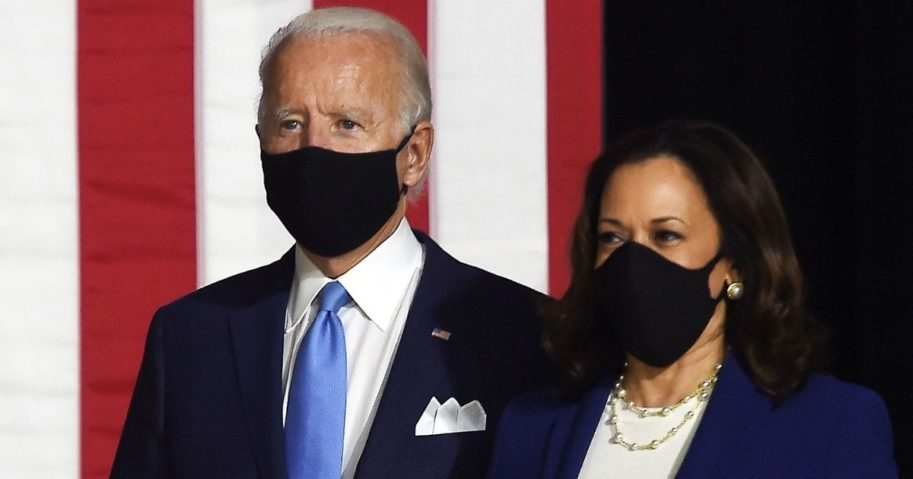 Democratic presidential nominee Joe Biden and his running mate, Sen. Kamala Harris, arrive for a news conference in Wilmington, Delaware, on Aug. 12.