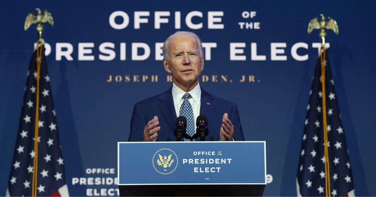 Democratic presidential candidate Joe Biden speaks to the media at the Queen Theater in Wilmington, Delaware, on Monday.