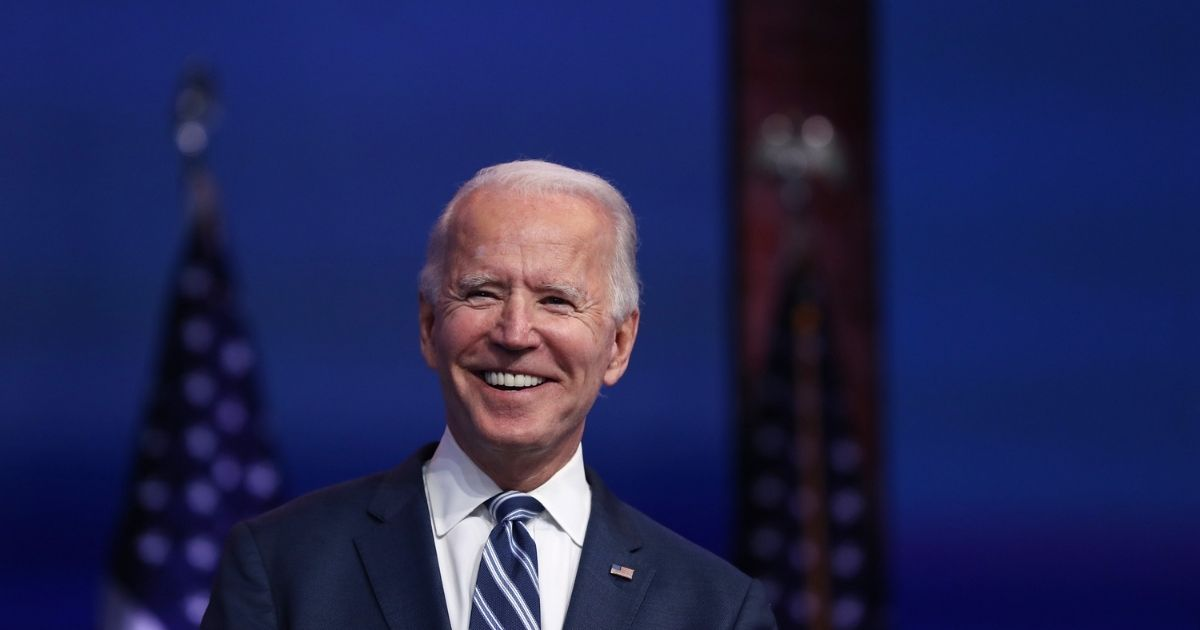 Democratic presidential nominee Joe Biden addresses the media about the Trump Administration's lawsuit to overturn the Affordable Care Act on Tuesday at the Queen Theater in Wilmington, Delaware.