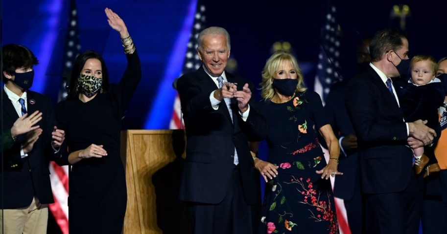 Hunter Biden, right, and other members of the Biden family stand on stage after Democratic presidential candidate Joe Biden delivered a victory speech Saturday in Wilmington, Delaware.