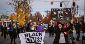Black Lives Matter demonstrators march in memoriam of Travis Nagdy in Jefferson Square Park on Nov. 23 in Louisville, Kentucky.