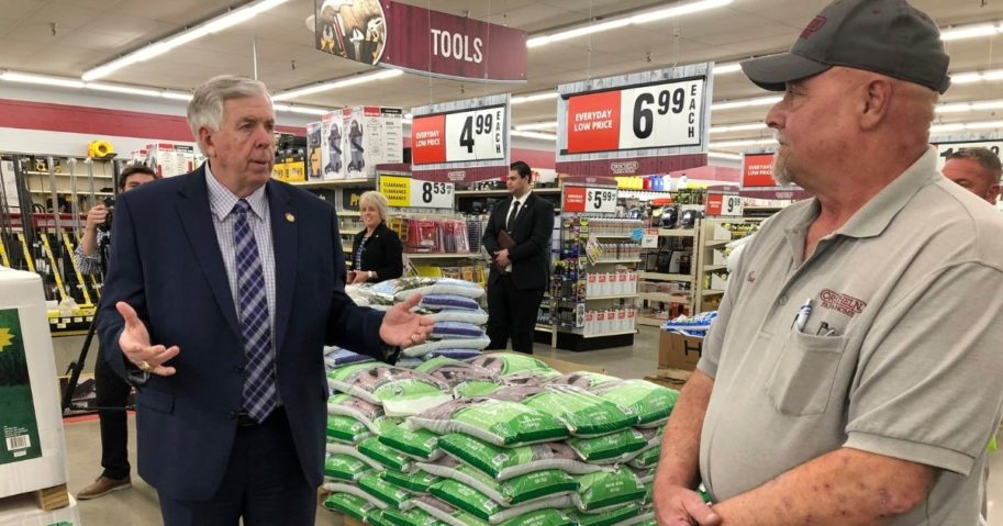 In this May 7 photo, Republican Missouri Gov. Mike Parson, left, talks with store manager Ron Schuman, right, during a tour of the Orscheln Farm & Home store in Jefferson City, Mo.