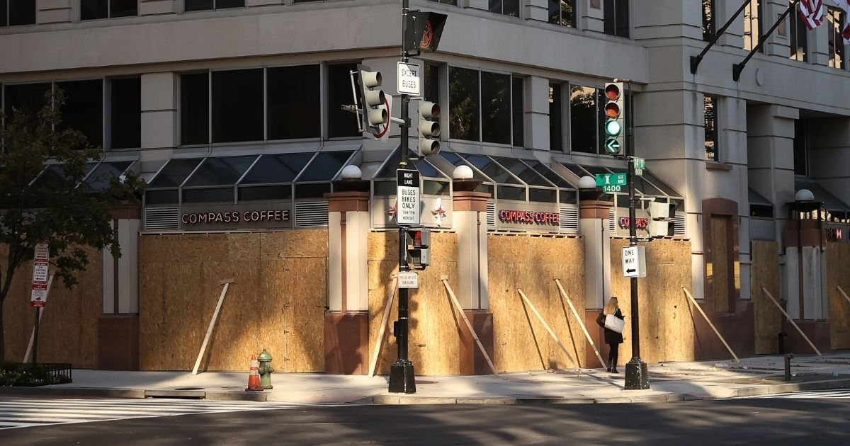 Retail businesses and office buildings are boarded up in anticipation of Election Day vandalism near the center of the nation's capital on Monday.