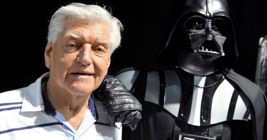 English actor David Prowse, left, who played the character of Darth Vader in the first Star Wars trilogy poses with a fan dressed up in a Darth Vader costume during a Star Wars convention on April 27, 2013, in Cusset.