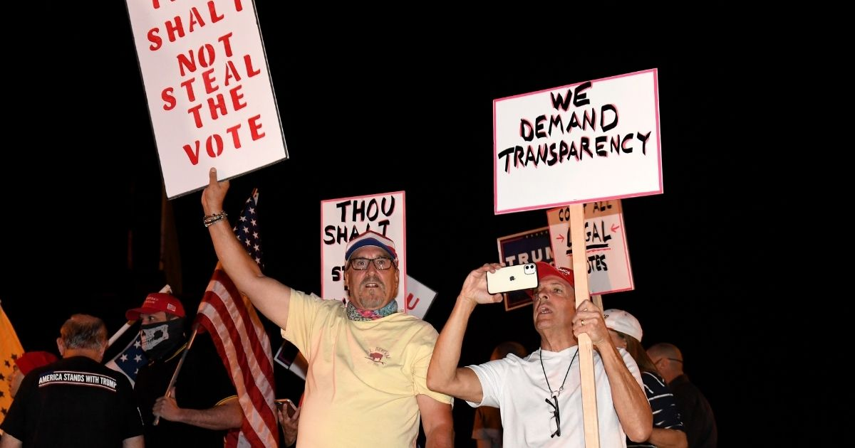 Demonstrators protest outside the Clark County Election Department